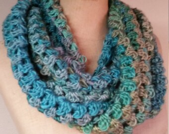 Versatile crocheted scarf with matching fingerless gloves