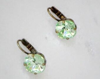 Austrian crystal 10mm mini  fancy square stone earrings in green chrysolite,antique brass pl.,light peridot earrings very sparkly & elegant
