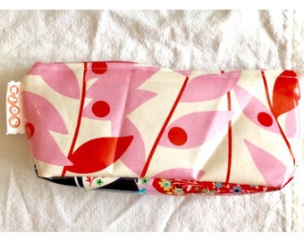 sofs offers a large laminated pouch. This one in red leaf.