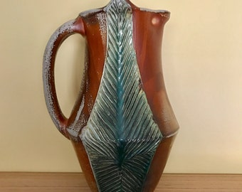 Large Carved Pitcher