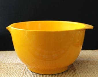 Bright orange Rosti Mepal Margrethe mixing bowl.