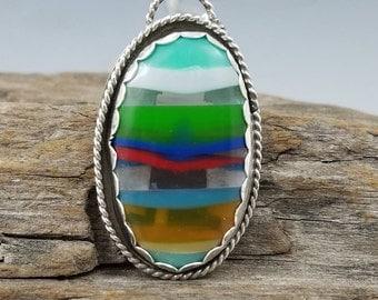 Surfite and argentium silver pendant