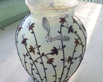 Barn Owl Flying over Wildflowers Sculpted with Polymer Clay onto a Recycled Glass Vase in Greyed Yellow