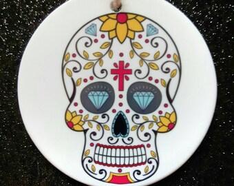 Sugar skull ceramic Christmas ornament.