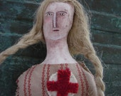 Folk art doll, woman doll with Red Cross patch on her dress, woman face doll, number six