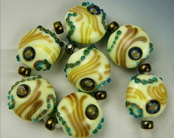 a set of 7 button or spree beads in pale green gold aqua & brown handmade lampwork glass - North Sea Shores