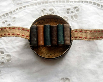The Dirty Half Dozen - Miniature Leather Bound Book Sextuplets in a Rusty Vintage Tin