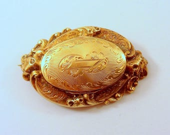 "1860's, 1 1/2"" x 1"" locket brooch"