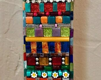 """Mosaic """"bling"""" letter I."""