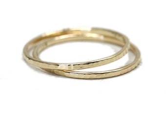 Pair of skinny solid gold rings in 14K yellow and rose gold, hammered stacking rings or knuckle rings