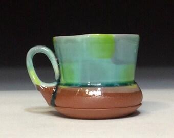bright green with copper glaze checkered patrern mug with ergonomic handle