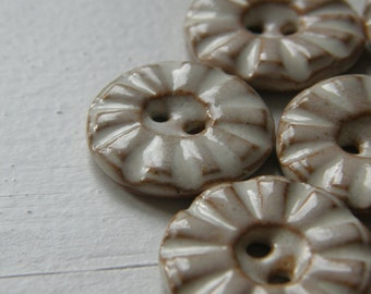 white textured handmade ceramic buttons