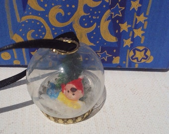 Handmade miniature Christmas dome pendant necklace with Boy on sled, tree, and snow. Christmas ornament.