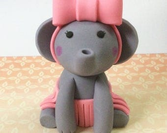 Baby elephant fondant cake topper with bow and skirt