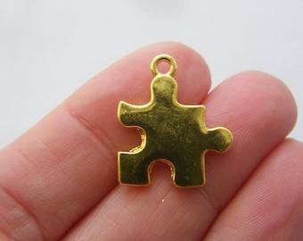 2 Puzzle piece charms gold tone GC89