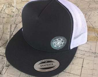 Hand painted snow flake patch on a charcoal gray snapback hat