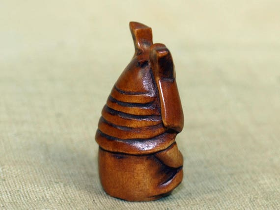 Hand carved boxwood ojime bead cute samurai baby oji