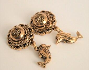 Vintage dolphin earrings.  Clip on earrings.  Golden dolphins