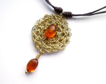 Crochet wire pendant from solid brass wire, natural Baltic amber bead and waxed cotton string with sliding knots