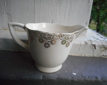 Vintage unsigned bone china creamer pitcher with handle