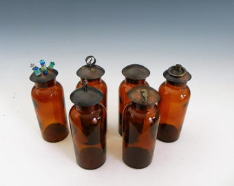 six glass jars with handmade copper lids