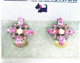 Blair Delmonico Clip-on Snow Flake Style Earrings with Medium & Light Pink Swarovski Crystals w/Pearl Centers in a Silver setting.
