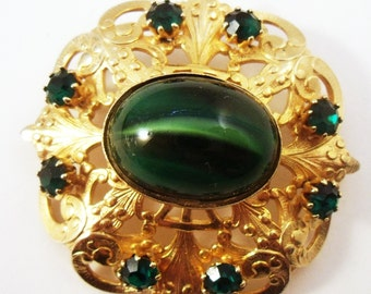 Green  art glass brooch in gold tone setting