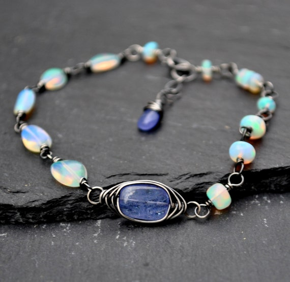 Genuine Opal Bracelet Aaa Ethiopian Welo Opal & Tanzanite. Romantic Necklace. Jaipur Bangles. Fake Engagement Rings. Lucite Necklace. Baptism Medallion. Personalized Baby Bracelet. Pure Gold Pendant. 10000 Rings