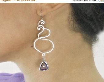 20% off. chandelier  Swirl earrings. Silver and purple drop earrings with Sterling silver ear wires and trillion drop.