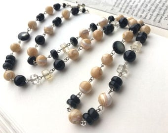 Obsidian and mother of pearl necklace: Her Radiant Masterpiece; opera length necklace, cream and black, rainbow obsidian, sterling silver