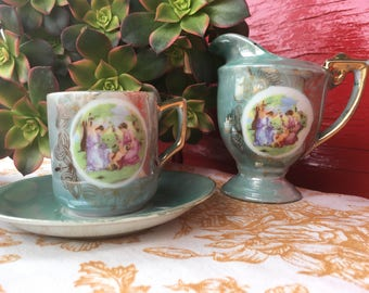 Lustreware creamer cup and saucer green with gold accents