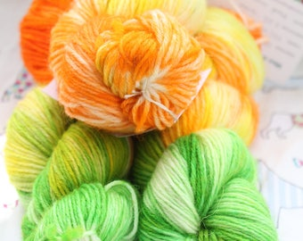 Hand dyed yarn, wool & nylon blend. 100gms. Orange, yellow and green. Citrus. DK.