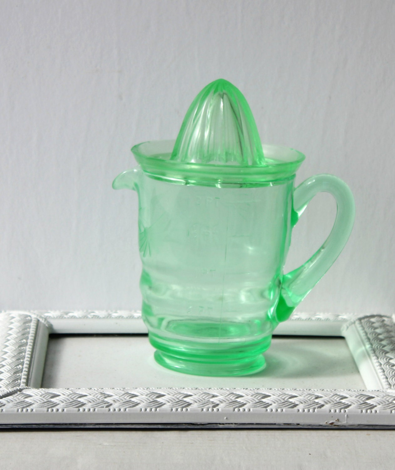 Vintage 4 cup pitcher with reamer