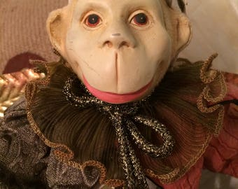 Adorable collectable vintage Jester Clown monkey with wings