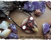 Faceted Garnet/Fossil Coral and Shivas Eye polymer clay Goddess Pendant/Necklace.