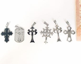 RESERVED LISTING 2 flat rate midium boxes full of stainless steel jewelry + all the pictured crosses