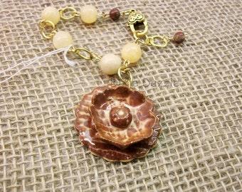 Ceramic flower bracelet with yellow jade. Stoneware clay charm by Dixie Dazzle, . One of a kind bracelet