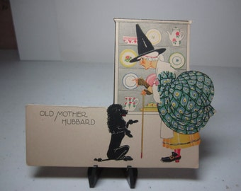 1923 unused P.F. Volland Mother Goose colorful die cut art deco Old King Cole place card