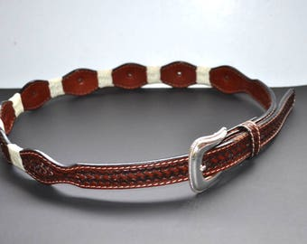 Vintage  brown hand  tooled leather belt size 34. Removable silver tone buckle Excellent condition