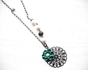 Long Necklace With Black Metal Charm and Teal Flower