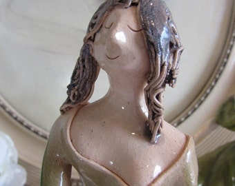 Vintage French collectable ceramic figurine.