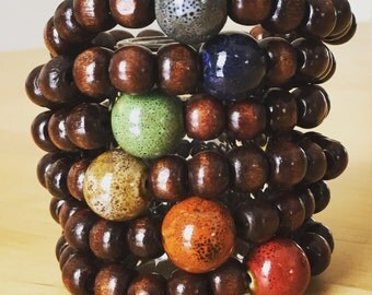 Yogi inspired wood bead mala meditation bracelet with large ceramic bead for men or women in multiple colors