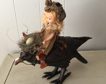 Delivery service assemblage art with altered crow babydoll nest and eggs