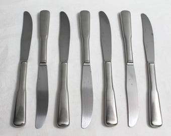 7 Dinner Knives by Oneida Wm A Rogers Stainless