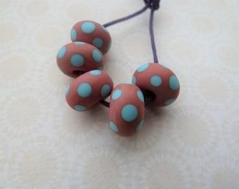 handmade lampwork glass beads, coral and blue spot set UK