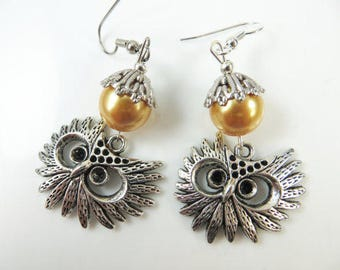 Large owl face earrings