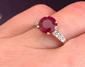 Natural Ruby and Diamond Ring. 14K yellow gold. Offering layaway.
