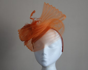 Orange Fascinator Hatinator with a wave of pleated crin on a Band Weddings Races Ascot Kentucky Derby