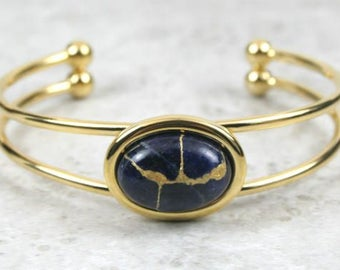 Kintsugi (kintsukuroi) cuff bracelet with sodalite stone cabochon with gold repair in a gold plated setting - OOAK