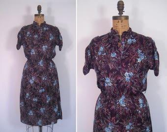 1970s aubergine floral leaf print dress • 70s purple and blue flower print dress • vintage story of love dress